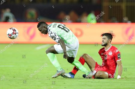 Tunisia's Ferjani Sassi (R) in action against Nigeria's Oghenekaro Etebo (L) during the 2019 Africa Cup of Nations (AFCON) third place soccer match between Tunisia and Nigeria in Al-Salam Stadium in Cairo, Egypt, 17 July 2019.