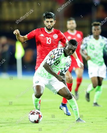 Tunisia's Ferjani Sassi (back) in action against Nigeria's Oghenekaro Etebo (front) during the 2019 Africa Cup of Nations (AFCON) third place soccer match between Tunisia and Nigeria in Al-Salam Stadium in Cairo, Egypt, 17 July 2019.