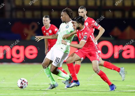 Tunisia's Ferjani Sassi (R) in action against Nigeria's Alex Iwobi (L) during the 2019 Africa Cup of Nations (AFCON) third place soccer match between Tunisia and Nigeria in Al-Salam Stadium in Cairo, Egypt, 17 July 2019.