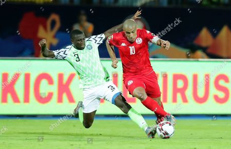 Tunisia's Wahbi Khazri (R) in action against Nigeria's Jamilu Collins (L) during the 2019 Africa Cup of Nations (AFCON) third place soccer match between Tunisia and Nigeria in Al-Salam Stadium in Cairo, Egypt, 17 July 2019.