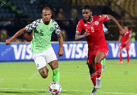Tunisia's Firas Chaouat (R) in action against Nigeria's William Troost-Ekong (L) during the 2019 Africa Cup of Nations (AFCON) third place soccer match between Tunisia and Nigeria in Al-Salam Stadium in Cairo, Egypt, 17 July 2019.