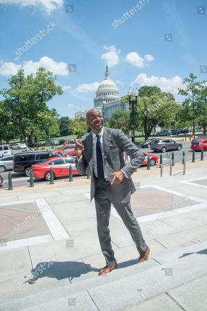 John Salley arrives at the annual PETA (People for the Ethical Treatment of Animals) Veggie dog lunch in front of the Rayburn House office building. PETA provided meat free hot dogs to crowds outside the building.