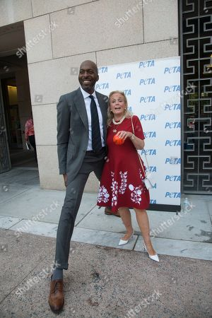 John Salley poses with Congresswoman Debbie Dingal, D-MI at the annual PETA (People for the Ethical Treatment of Animals) during the annual Veggiie dog lucnh in front of the Rayburn House office building. PETA provided meat free hot dogs to crowds outside the building.