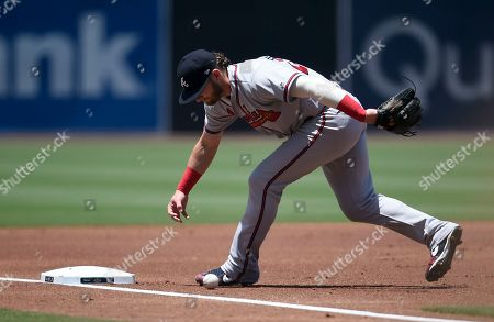 Atlanta Braves third baseman Josh Donaldson fields a ball during the first inning of a baseball game against the San Diego Padres in San Diego