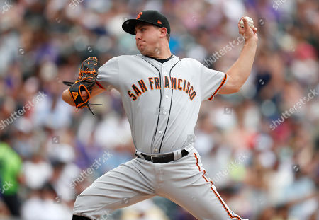 R m. San Francisco Giants relief pitcher Derek Holland works against the Colorado Rockies in the fifth inning of a baseball game, in Denver