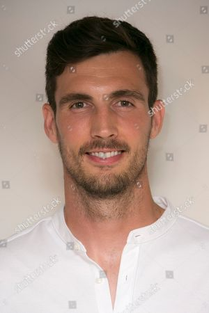 Steve Finn. Cricketer Steven Finn poses for photographers upon arrival at 'The Edge' European premiere in central London