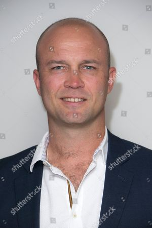 Stock Image of Former cricketer Jonathan Trott poses for photographers upon arrival at 'The Edge' European premiere in central London