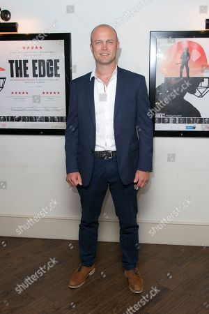 Stock Photo of Former cricketer Jonathan Trott poses for photographers upon arrival at 'The Edge' European premiere in central London