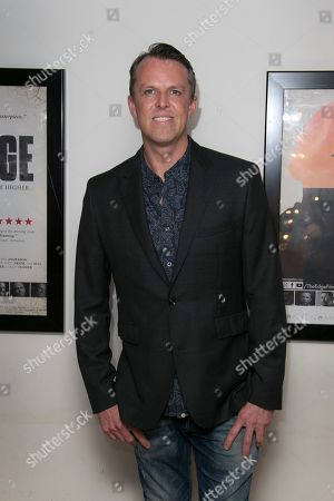 Former cricketer Graeme Swann poses for photographers upon arrival at 'The Edge' European premiere in central London
