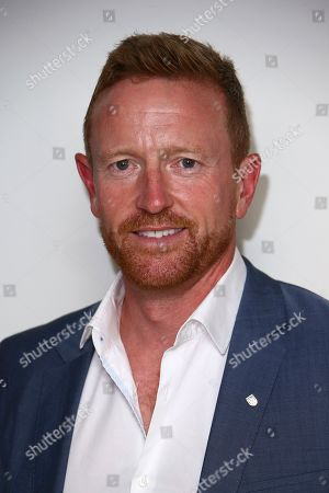 Former cricketer Paul Collingwood poses for photographers upon arrival at 'The Edge' European premiere in central London