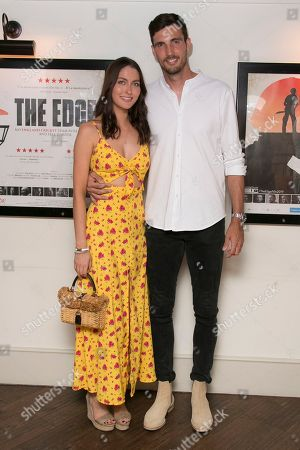 Steve Finn. Cricketer Steven Finn and partner Amber pose for photographers upon arrival at 'The Edge' European premiere in central London