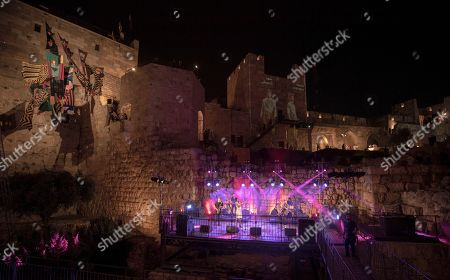 Israel singer Ester Rada (C) performs during the Overall festival at  the Tower of David in Jerusalem's Old City, 17 July 2019. The cultural event celebrates contemporary fashion and is held at the Tower of David Museum next to the Jaffa Gate of Jerusalem's Old City from 17 to 20 July. The festival includes events, fashion tours and exhibits.