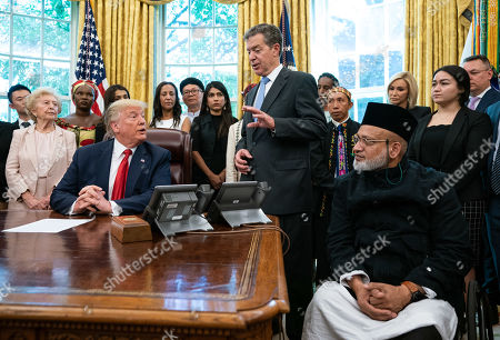 Sam Brownback, United States Ambassador-at-Large for International Religious Freedom, speaks as US President Donald Trump welcomes survivors of religious persecution to the Oval Office at the White House