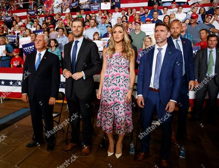 From left, Vice President Mike Pence, Eric Trump, the son of President Donald Trump, and his wife Lara Trump and her brother Kyle Yunaska look to the stage as President Donald Trump speaks at a campaign rally at Williams Arena in Greenville, N.C