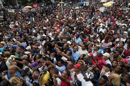 Hundreds of people participate in a march led by former Dominican President Leonel Fernandez against the possible constitutional reform that would allow again the re-election of current Dominican President Danilo Medina, in front of the National Congress, in Santo Domingo, Dominican Republic, 17 July 2019. Fernandez led this demonstration while strong rumors circulated that lawmakers related to Medina are preparing to submit to the Senate a draft constitutional reform to enable the president to participate in the elections of 2020. The issue of constitutional reform has caused a strong division in the bosom of the Party of the Dominican Liberation (PLD), a party that has held power since 2004, and has generated strong tensions in the National Congress.