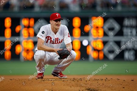 Philadelphia Phillies starting pitcher Nick Pivetta reacts after walking Los Angeles Dodgers' David Freese during the first inning of a baseball game, in Philadelphia
