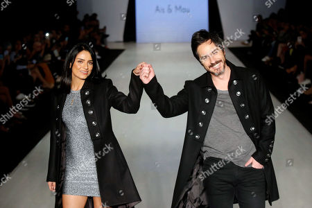 Mexican actors Aislinn Derbez (L) and Mauricio Ochmann (R) exhibits creations by Mexican designer Jaime Kohen during the 71st edition of Intermoda in Guadalajara, Jalisco state, Mexico, 17 July 2019.