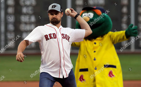 NASCAR driver Ricky Stenhouse Jr. delivers the ceremonial first pitch prior to a baseball game between the Boston Red Sox and Toronto Blue Jays at Fenway Park in Boston