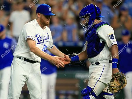 Ian Kennedy, Meibrys Viloria. Kansas City Royals relief pitcher Ian Kennedy, left, shakes hands with catcher Meibrys Viloria following the team's baseball game against the Chicago White Sox at Kauffman Stadium in Kansas City, Mo., . The Royals won 7-5
