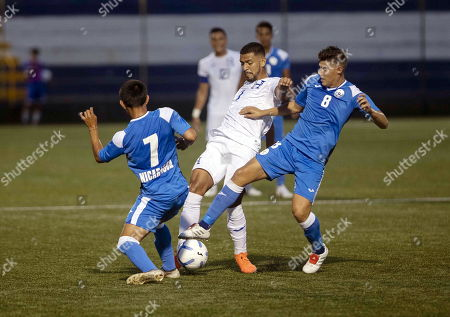 Luis Peralta (R) and Jonathan Moncada (L) of Nicaragua vies for the ball against Jose Reyes (C) of Honduras during an Under-23 Central American Olympic qualifying match between Nicaragua and Honduras in Managua, Nicaragua, 17 July 2019.