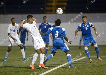 Jason Ingram (R) of Nicaragua vies for the ball against Jose Reyes (L) of Honduras during an Under-23 Central American Olympic qualifying match between Nicaragua and Honduras in Managua, Nicaragua, 17 July 2019.