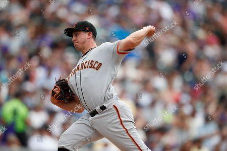 R m. San Francisco Giants starting pitcher Derek Holland (45) in the fifth inning of a baseball game, in Denver