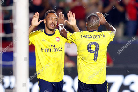Stock Image of Pierre-Emerick Aubameyang of Arsenal FC (L) and Alexandre Lacazette of Arsenal FC celebrate after Louis Poznanski (R) of FC Bayern Munich accidentally scored against his own team on a center by Pierre-Emerick Aubameyang of Arsenal FC during the match between FC Bayern Munich and Arsenal FC at Dignity Health Sports Park in Carson, California, USA, 17 July 2019.