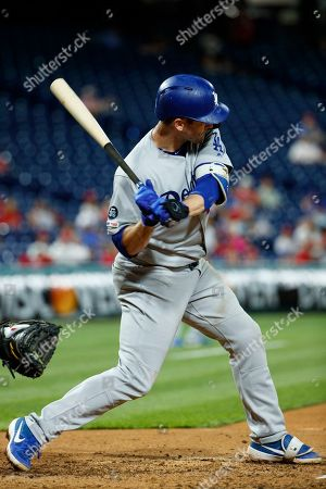 Los Angeles Dodgers' David Freese swings for a two-run home run off Philadelphia Phillies relief pitcher Juan Nicasio during the seventh inning of a rain-delayed baseball game, early Thursday morning, in Philadelphia. Los Angeles won 7-2