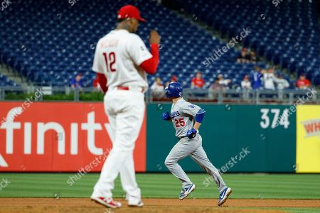 Juan Nicasio, David Freese. Los Angeles Dodgers' David Freese, right, rounds the bases past Philadelphia Phillies relief pitcher Juan Nicasio during the seventh inning of a rain-delayed baseball game, early Thursday morning, in Philadelphia. Los Angeles won 7-2