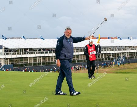 Darren Clarke celebrates after making a birdie putt on the 1st hole during Round 1 of the 148th Open Championship.