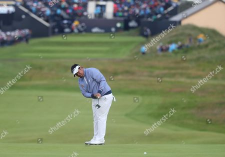 Thailand's Kiradech Aphibarnrat putts on the 1st green during the first round of the British Open Golf Championships at Royal Portrush in Northern Ireland