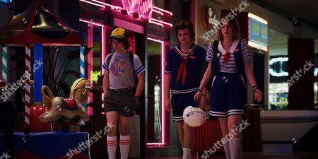 Gaten Matarazzo as Dustin Henderson, Joe Keery as Steve Harrington and Maya Thurman Hawke as Robin