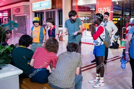 Gaten Matarazzo as Dustin Henderson, Noah Schnapp as Will Byers, Ross Duffer Creator and Caleb McLaughlin as Lucas Sinclair