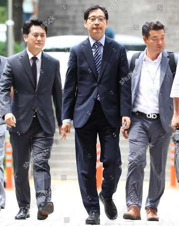 Stock Picture of South Gyeongsang Province Govenor Kim Kyoung-soo (C), a confidant of President Moon Jae-in, arrives at the Seoul High Court to attend a trial, in Seoul, South Korea, 18 July 2019. Kim was bailed on April 17 after he was sentenced to two years in prison in January for colluding with a power blogger to carry out an illicit cyber operation to sway public opinion in favor of Moon ahead of the 2017 presidential election.
