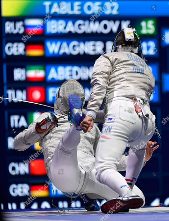 Csanad Gemesi of Hungary (R) and Aldo Montano of Italy in action in the men's individual sabre competition of the FIE World Fencing Championships in Budapest, Hungary, 18 July 2019.