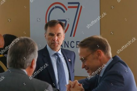 Canada's Finance Minister Bill Morneau, center, arrives to a meeting at the G-7 Finance in Chantilly, north of Paris, on