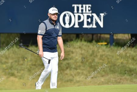 Tyrrell Hatton walks the course