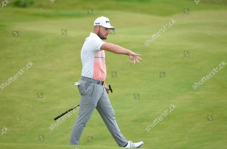 Tyrrell Hatton of England reacts on the second green