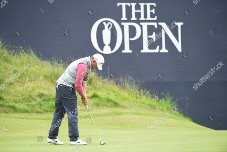 Lee Westwood of England putts the ball into the 18th hole