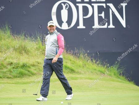 Lee Westwood of England smiles on the 18th green