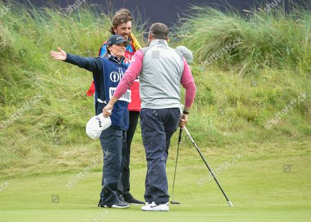 Helen Storey, girlfriend and caddie of Lee Westwood, embraces Lee Westwood on the 18th green