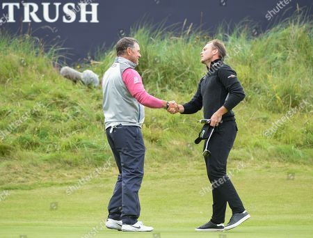 Lee Westwood of England shakes hands with Danny Willett on the 18th green