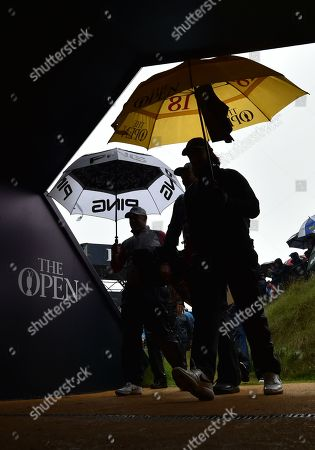 Tommy Fleetwood and Lee Westwood of England both arrive at the tunnel between the 9th and 11th at the same time