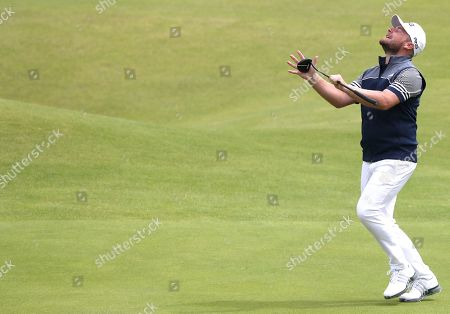 Tyrrell Hatton reacts after missing a putt on the 18th