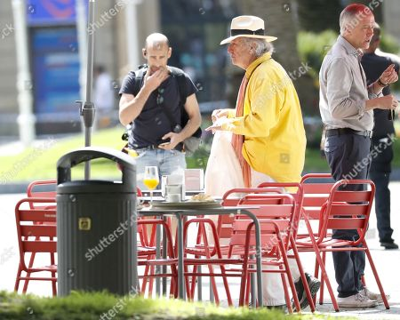Italian cinematographer Vittorio Storaro (C) walks at the set of US filmmaker and actor Woody Allen latest film's shooting in San Sebastian, Spain, 18 July 2019. Allen shoots his latest work from 10 July to 23 August in San Sebastian.