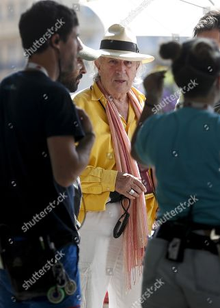 Stock Photo of Italian cinematographer Vittorio Storaro (C) stands at the set of US filmmaker and actor Woody Allen latest film's shooting in San Sebastian, Spain, 18 July 2019. Allen shoots his latest work from 10 July to 23 August in San Sebastian.
