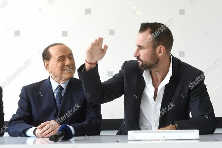 Former Italian Prime Minister, Forza Italia president and A.C. Monza owner Silvio Berlusconi attends a press conference illustrating the partnership with German stylist Philipp Plein (R) in Lugano, Switzerland, 18 July 2019.