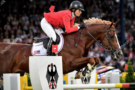 Elizabeth Madden of the United States on Darry Lou competes in the Nations' Cup team jumping event at the CHIO in Aachen, Germany, 18 July 2019.