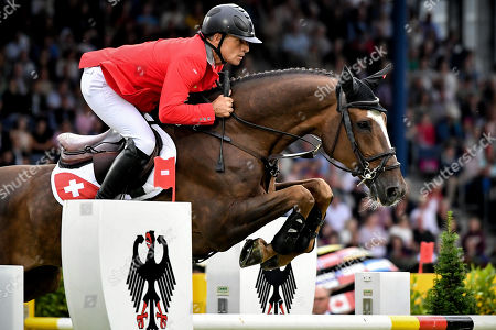 Stock Picture of Pius Schwizer of Switzerland on Courtney Cox competes in the Nations' Cup team jumping event at the CHIO in Aachen, Germany, 18 July 2019.