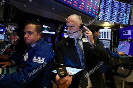 Gennaro Saporito, Robert Moran. Specialist Gennaro Saporito, left, and trader Robert Moran work on the floor of the New York Stock Exchange, . U.S. stocks moved lower in early trading on Wall Street Thursday after Netflix reported a slump in new subscribers and dragged down communications companies
